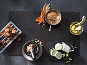 Aromatic salt, garlic confit, sauce ice cubes, herb butter