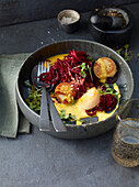 Scallops with beetroot zoodles and vanilla-orange butter