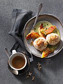 Quark dumplings with caramel quince and a pistachio-and-rosemary sauce