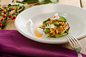 Chanterelle salad with cucumber and poppy seed oil