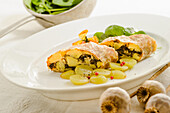 Potato-poppy seed strudel with grapes