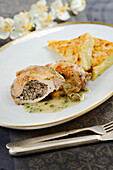 Chicken cutlet with poppy seed stuffing served over caper sauce