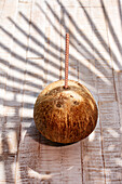 Coconut with drinking straw