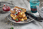 French toast with jam, toasted almonds and mint