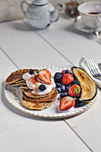 Pancakes with strawberry curd, grilled banana and fresh berries