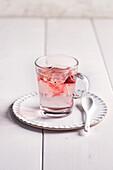 Brewed fruit tea in a glass mug