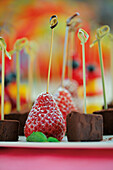 Strawberry skewers and chocolate truffle skewers