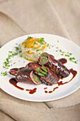 Beef involtini braised in red wine with kumquat-coriander rice