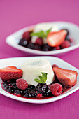 Coconut panna cotta on a port wine-and-berry sauce