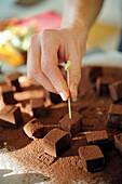 Prepare chocolate truffle skewers: Skewering truffles