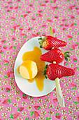 Vanilla tonka bean ice cream with strawberry-lemongrass skewer