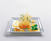 Jellied orange blossom vinegar with kataifi and pea cress