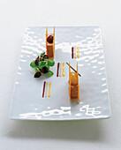 Honey cake sandwich with foie gras, persimmon and orange cream