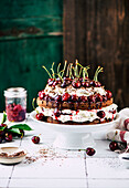 Chocolate tart with cherries and poppy seeds