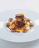 Saddle of venison with kumquat meringue, juniper syrup, creamed corn and pretzel dumpling slices