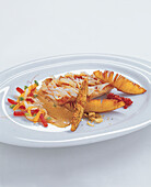 Red mullet cooked crispy on alici oil with chorizo and chilli potatoes