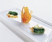 Mustard cabbage leaves stuffed with Norway lobster, white cabbage powder and crisps