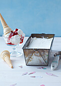 Yoghurt ice cream with raspberry topping