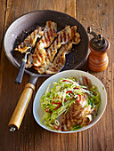 White cabbage and horseradish salad with pork belly strips