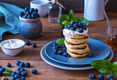 Cottage cheese pancakes with sour cream and blueberries