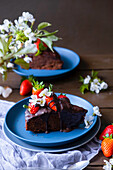 Brownie with chocolate sauce and strawberries
