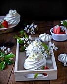 Pavlova dessert with cream and strawberries