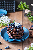 Chocolate waffles with blueberries and chocolate sauce