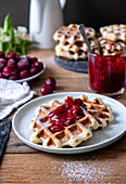 Belgian waffles with fresh yeast and cherry sauce
