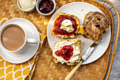 Tea and scones with clotted cream and strawberry jam