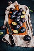 Plums on a Slicing Board
