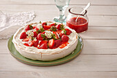 Meringue tart Pavlova with strawberries
