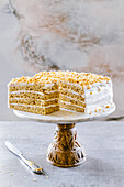 Honey vanilla cake, layers of sponge and cream, covered with a vanilla frosting.