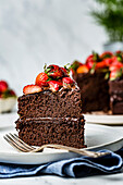 A chocolate cake decorated with fresh chopped strawberries