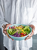 Buddha Bowl being held in a persons hands