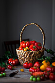 Wicker basket filled with heirloom tomatoes.