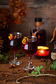 Glasses of damson gin liqueur served in sherry glasses with a twist of orange zest.