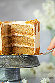A slice of vegan cookie butter layer cake being sliced ans served