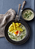 Dill sauce with poched egg