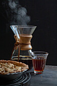 Chemex carafe with a coffee glass and apple pie