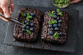 Brownie cake with blueberries and mint leaves
