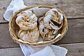 Vegan yeast dough wreaths filled with vanilla cream, plum jam and apricot jam
