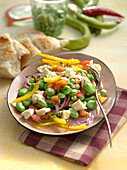 Broad bean salad with peppers and feta cheese