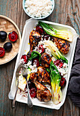 Chicken legs with plums and bok choy