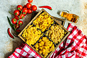 Vintage wooden box with variety of rItalian pasta like farfalle, conchiglie, rotelle and macaroni