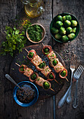 Grilled salmon skewers with bacon and Brussels sprouts
