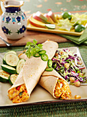 Chicken and cheese enchiladas with sauteed zucchini squash and cabbage slaw