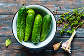 Cucumbers in a bowl with thyme and garlic