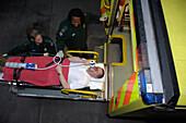 Paramedic monitors a patient