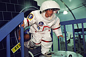 Student wearing a space suit at space camp