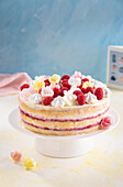 A naked cake with a raspberry-and-mascarpone filling